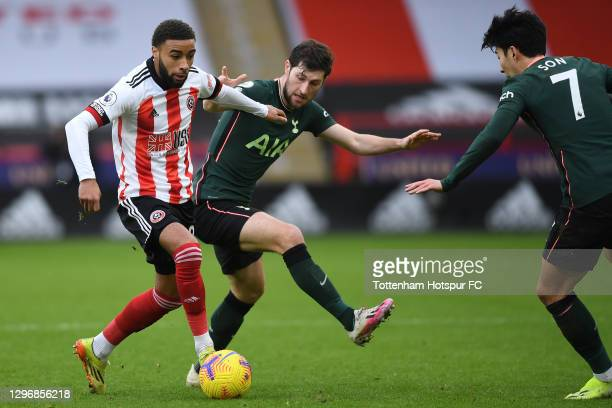 Jayden Bogle of Sheffield United is closed down by Ben Davies of Tottenham Hotspur during the Premier League match between Sheffield United and...