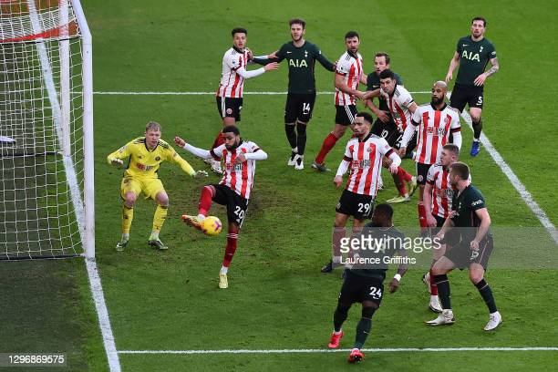 Jayden Bogle of Sheffield United looks to clear the ball from a corner during the Premier League match between Sheffield United and Tottenham Hotspur...