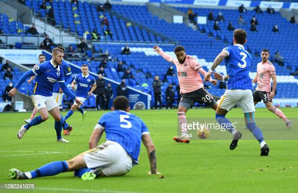 Jayden Bogle of Sheffield United scores their team's first goal during the Premier League match between Brighton & Hove Albion and Sheffield United...