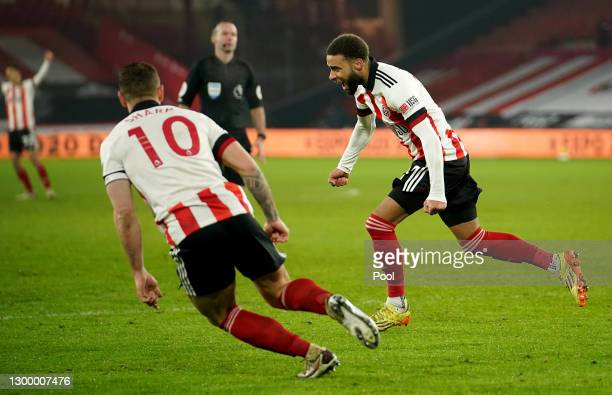 Jayden Bogle of Sheffield Unitedcelebrates after scoring their side's first goal during the Premier League match between Sheffield United and West...