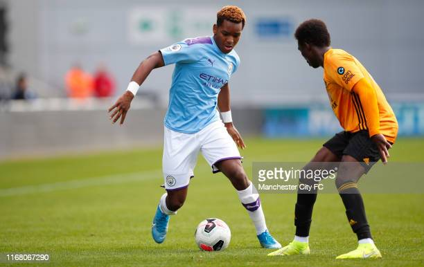 Jayden Braaf of Manchester City and John Kitolano of Wolverhampton Wanderers during the Premier League 2 match between Manchester City U23 and...