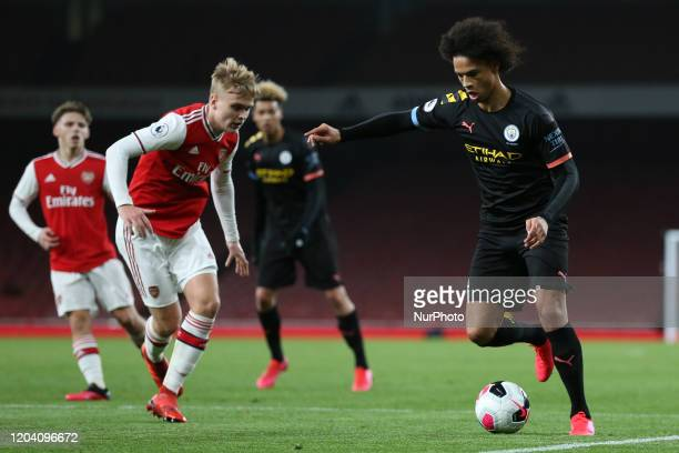 Jayden Braaf of Manchester City u23 taking on Matthew Smith of Arsenal u23 during the Premier League 2 match between Arsenal Under 23 and Manchester...