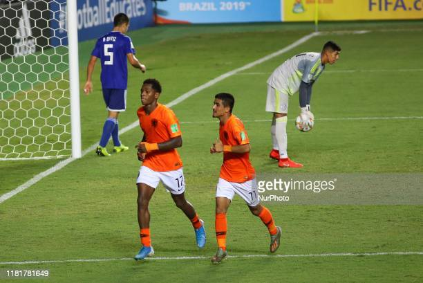 Jayden Braaf of Netherlands celebrates the third goal for his team with his teammates during the quarterfinal match between Netherlands and Paraguay...