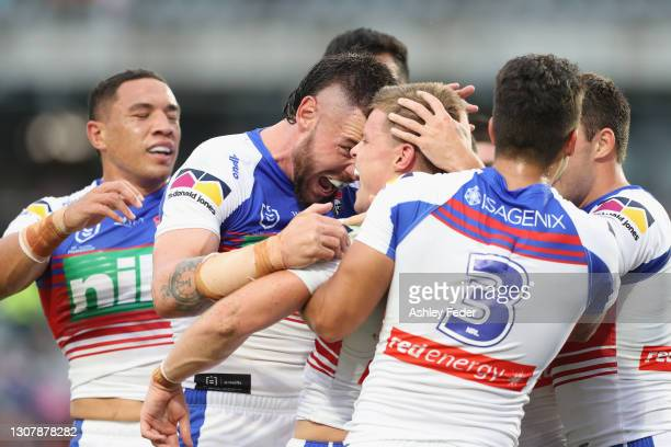 Jayden Brailey of the Knights celebrates his try with team mates during the round two NRL match between the New Zealand Warriors and the Newcastle...