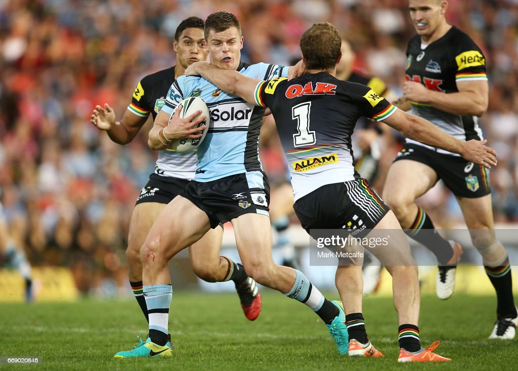 Jayden Brailey of the Sharks is tackled during the round seven NRL match between the Penrith Panthers and the Cronulla Sharks at Pepper Stadium on April 16, 2017 in Sydney, Australia.