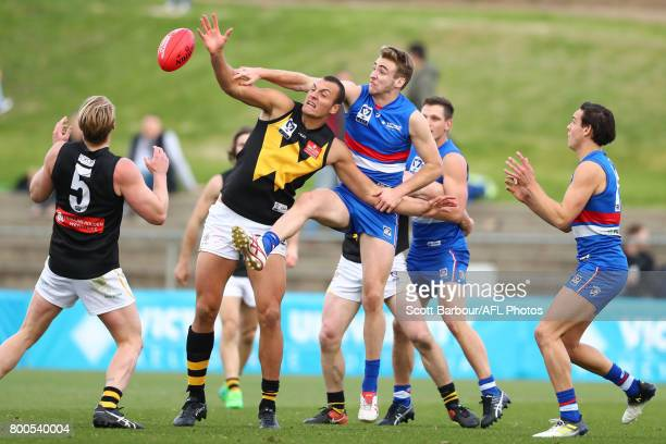 Jayden Foster of the Bulldogs and Braydon Preuss of Werribee compete for the ball during the 2017 VFL round 10 match between the Footscray Bulldogs...