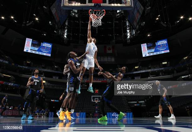 Jayden Hardaway of the Memphis Tigers dunks the ball against Rey Idowu of the Tulsa Golden Hurricane during a game on December 21, 2020 at FedExForum...