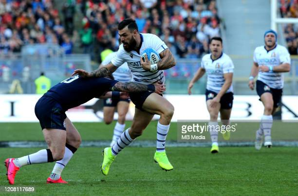Jayden Hayward of Italy is tackled from Stuart Hogg of Scotland during the 2020 Guinness Six Nations match between Italy and Scotland at Stadio...