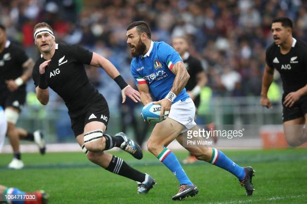 Jayden Hayward of Italy runs the ball during the International Rugby match between the New Zealand All Blacks and Italy at Stadio Olimpico on...