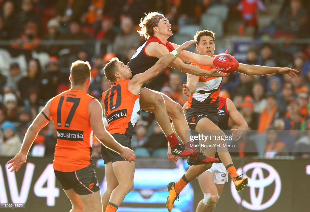 Jayden Hunt of the Demons and Josh Kelly of the Giants contest a mark during the round 20 AFL match between the Greater Western Sydney Giants and the Melbourne Demons at UNSW Canberra Oval on August 5, 2017 in Canberra, Australia.