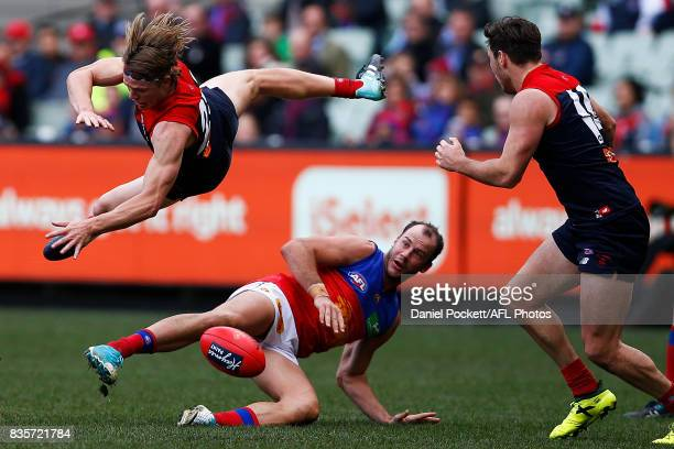 Jayden Hunt of the Demons and Josh Walker of the Lions contest the ball during the round 22 AFL match between the Melbourne Demons and the Brisbane...