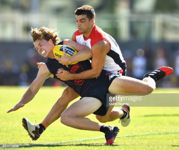 Jayden Hunt of the Demons is tackled by Corey Maynard during the Melbourne Demons AFL IntraClub match on February 10 2017 in Melbourne Australia