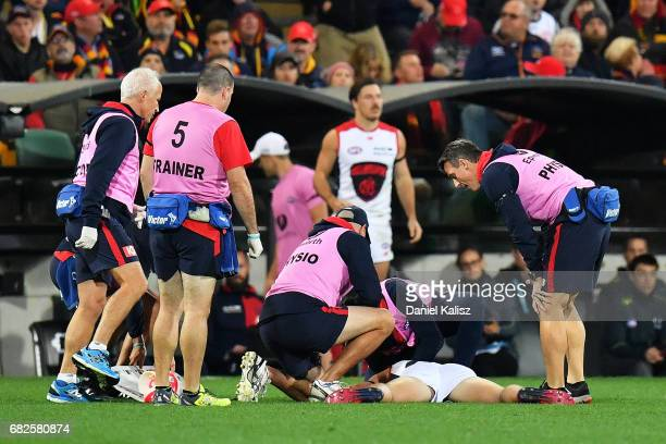 Jayden Hunt of the Demons lays on the ground after colliding with Sam Jacobs of the Crows during the round eight AFL match between the Adelaide Crows...