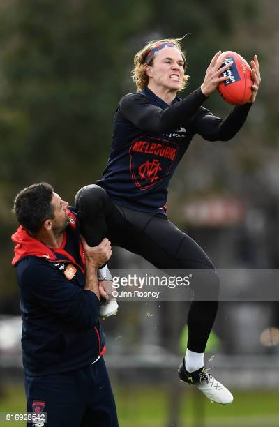Jayden Hunt of the Demons marks during a Melbourne Demons AFL training session at Gosch's Paddock on July 18 2017 in Melbourne Australia