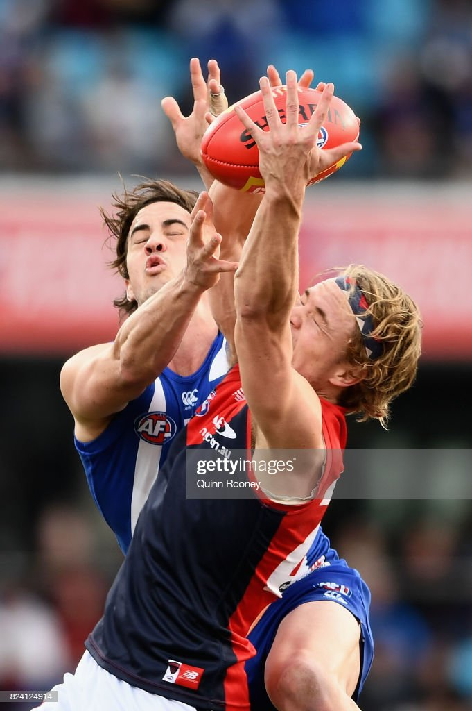 Jayden Hunt of the Demons marks infront of Taylor Garner of the Kangaroos during the round 19 AFL match between the North Melbourne Kangaroos and the Melbourne Demons at Blundstone Arena on July 29, 2017 in Hobart, Australia.