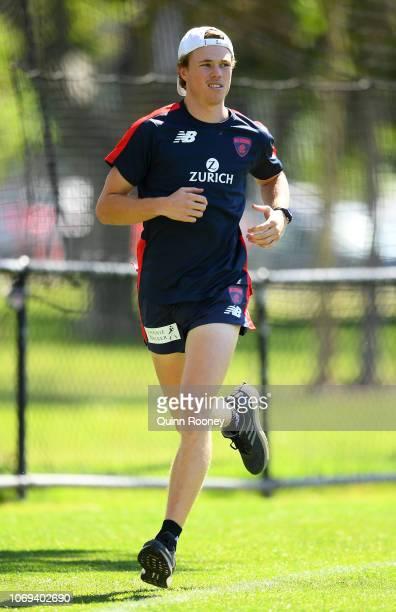 Jayden Hunt of the Demons runs laps during a Melbourne Demons AFL training session at Gosch's Paddock on November 19 2018 in Melbourne Australia