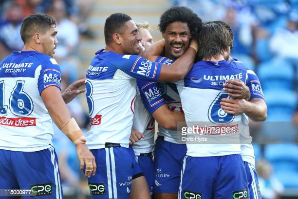 Jayden Okunbor of the Bulldogs celebrates a try during the round 10 NRL match between the Gold Coast Titans and the Canterbury Bulldogs at Cbus Super...