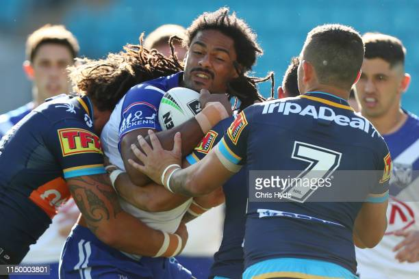 Jayden Okunbor of the Bulldogs is tackled during the round 10 NRL match between the Gold Coast Titans and the Canterbury Bulldogs at Cbus Super...