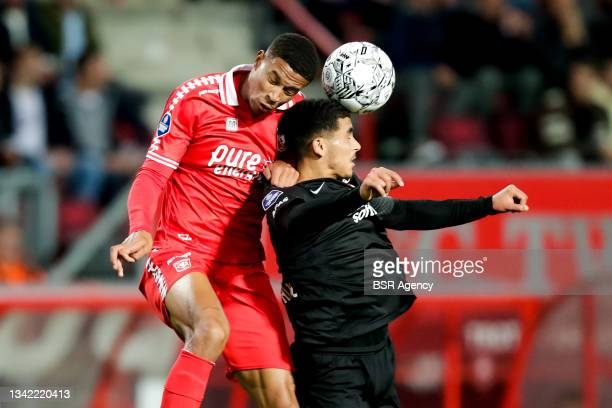 Jayden Oosterwolde of FC Twente competes for the headed ball with Zakaria Aboukhlal of AZ during the Dutch Eredivisie match between FC Twente and AZ...