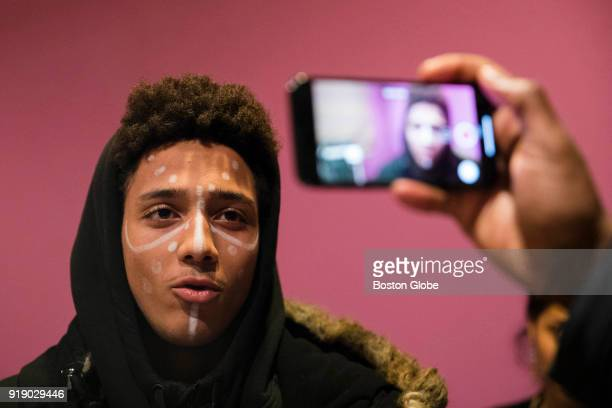 Jayden Pontes a student from Boston Arts Academy is filmed wearing face paint similar to characters from the 'Black Panther' comic book series during...