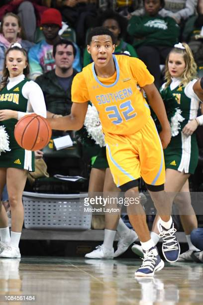 Jayden Saddler of the Southern University Jaguars dribbles up court during a college basketball game against the George Mason Patriots at the Eagle...
