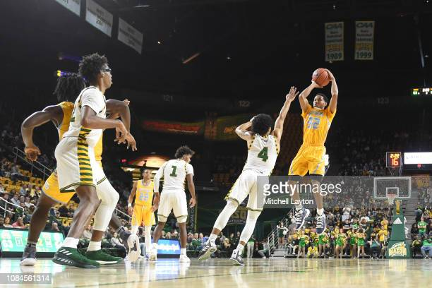 Jayden Saddler of the Southern University Jaguars takes a shot over Otis Livingston II of the George Mason Patriots during a college basketball game...