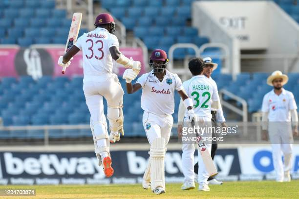 Jayden Seales and Kemar Roach of West Indies celebrate winning on day 4 of the 1st Test between West Indies and Pakistan at Sabina Park, Kingston,...