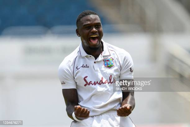 Jayden Seales of West Indies celebrates the dismissal of Fawad Alam of Pakistan during day 3 of the 1st Test between West Indies and Pakistan at...
