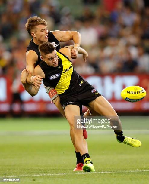 Jayden Short of the Tigers and Patrick Cripps of the Blues in action during the 2018 AFL round 01 match between the Richmond Tigers and the Carlton...