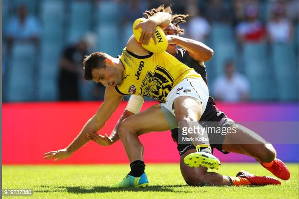Jayden Short of the Tigers is tackled Aiden Bonar of the Giants during the AFLX match between GWS Giants and the Richmond Tigers at Allianz Stadium...
