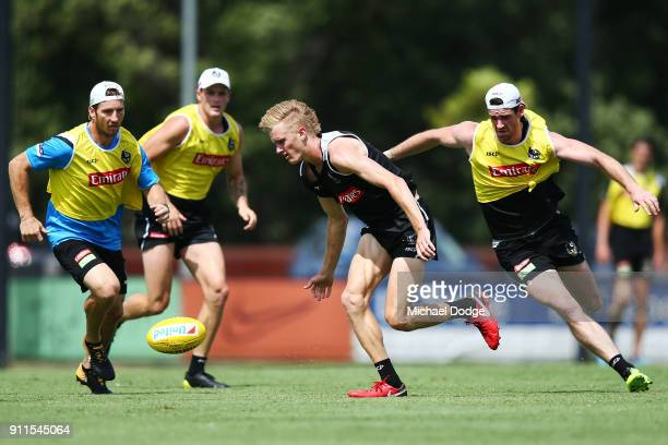 Jayden Stephenson competes for the ball against Tyson Goldsack during a Collingwood Magpies AFL training session on January 29 2018 in Melbourne...