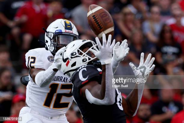 Jayden Stinson of the Murray State Racers makes a catch while being guarded by Davontae McKee of the Murray State Racers in the third quarter at...