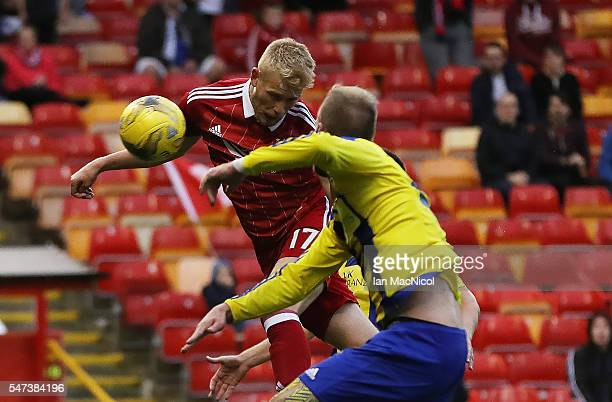 Jayden Stockley of Aberdeen scores the opening goal during the UEFA Europa league second qualifying round first leg match between Aberdeen and...