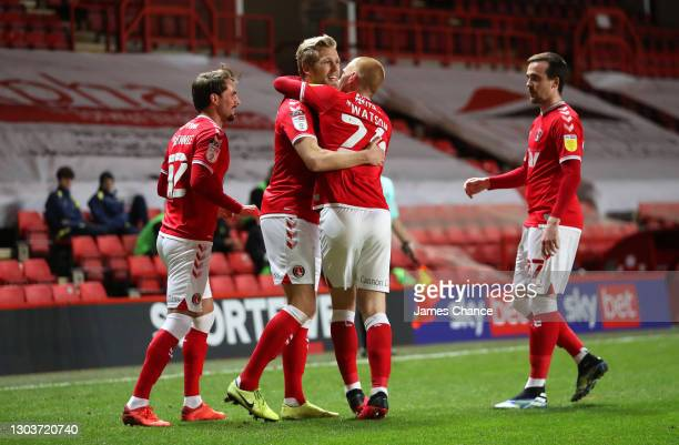 Jayden Stockley of Charlton Athletic celebrates with AndrewShinnie, Ben Watson and Liam Millar after scoring his sides first goal during the Sky Bet...