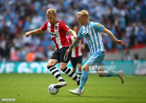 Jayden Stockley of Exeter City and Jack Grimmer of Coventry City in action during the Sky Bet League Two Play Off Final between Coventry City and...