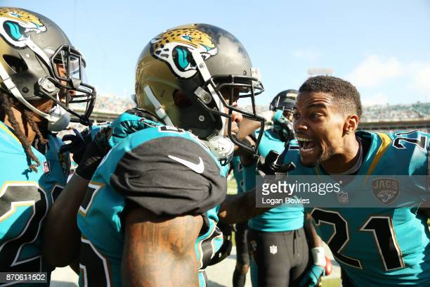 Jaydon Mickens and AJ Bouye of the Jacksonville Jaguars celebrate after Mickens scored a touchdown on a 63yard punt return in the second half of...