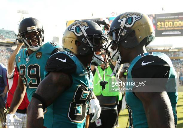 Jaydon Mickens and Marqise Lee of the Jacksonville Jaguars celebrate after Mickens scored a touchdown on a 63yard punt return in the second half of...