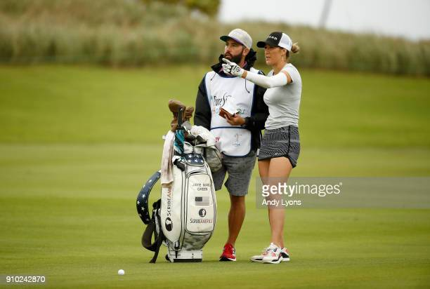 Jaye Marie Green and her caddie lin up her second shot on the 4th hole during the first round of the Pure Silk Bahamas LPGA Classic at the Ocean Club...