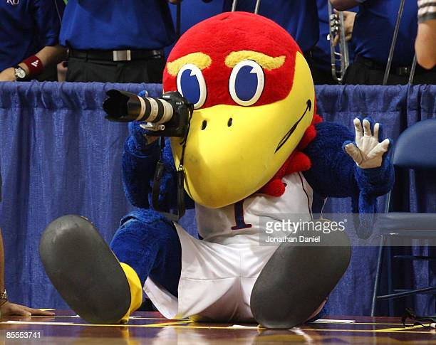 Jayhawk, the mascot for the Kansas Jayhawks takes pictures with a camera from the photographer row against the Dayton Flyers during the second round...