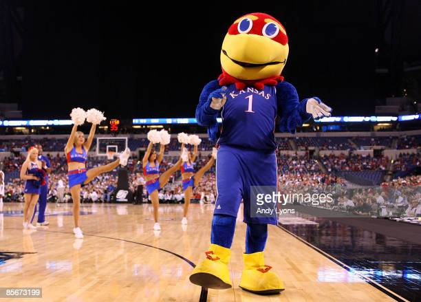 Jayhawk the mascot of the Kansas Jayhawks performs along with the Kansas cheerleaders the Michigan State Spartans during the third round of the NCAA...