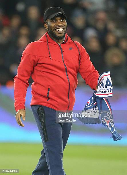 Jay-Jay Okocha gives the kick off before the French Ligue 1 match between Paris Saint-Germain v AS Monaco at Parc des Princes on March 20, 2016 in...