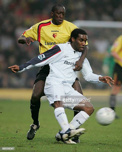 Jay-Jay Okocha of Bolton Wanderers tussles for posession with Toumani Diagouraga of Watford during the FA Cup third round match between Watford and...