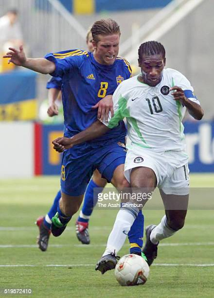 JayJay Okocha of Nigeria and Anders Svensson of Sweden compete for the ball during the FIFA World Cup Korea/Japan Group F match between Sweden and...