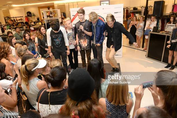 Jayk Purdy Devin Fox TC Carter Blake English and Drew Ryan Scott of After Romeo perform in Nordstrom during Teen Vogue's BacktoSchool Saturday at The...