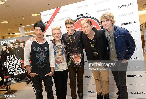 Jayk Purdy Devin FoxTC Carter Drew Ryan Scott and Blake English of After Romeo pose for photos in Nordstrom during Teen Vogue's BacktoSchool Saturday...