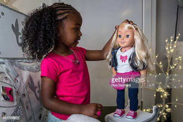 Jayla aged 4 plays with a 'My Friend Cayla' doll in the Hamleys toy shop on June 26 2014 in London England The doll which uses Bluetooth technology...