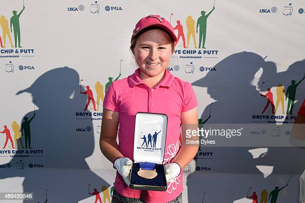 Jayla Kucy poses with her medal after winning the Chipping competition in the Girls 10 11 yr old division during the Drive Chip and Putt regional...