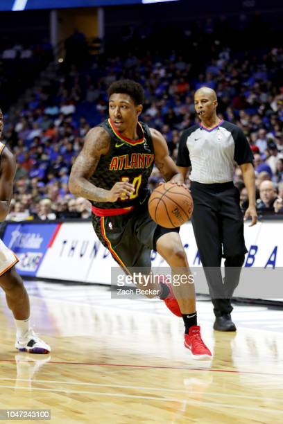 Jaylen Adams of the Atlanta Hawks handles the ball against the Oklahoma City Thunder during a preseason game on October 7 2018 at BOK Center in Tulsa...