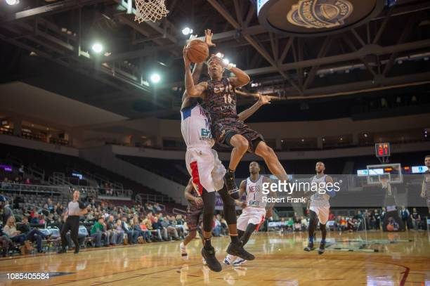 Jaylen Adams of the Erie BayHawks is fouled while shooting by Okaro White of the Long Island Nets during an NBA GLeague game on January 19 2019 at...