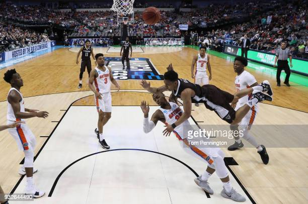 Jaylen Adams of the St Bonaventure Bonnies collides with Keith Stone of the Florida Gators as he goes up for a shot in the first half in the first...